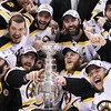 The Boston Bruins pose for a photograph with the Stanley Cup following their 4-0 win over the Vancouver Canucks in Game 7 of the NHL hockey Stanley Cup Finals on Wednesday, June 15, 2011, in Vancouver, British Columbia. (AP Photo/The Canadian Press, Jonathan Hayward)