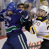 Boston Bruins left wing Daniel Paille (20) checks Vancouver Canucks right wing Maxim Lapierre during the first period during Game 7 of the NHL hockey Stanley Cup Finals, Wednesday, June 15, 2011, in Vancouver, British Columbia. (AP Photo/Julie Jacobson)