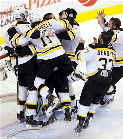 Boston Bruins celebrate after defeating the Vancouver Canucks 4-0 in Game 7 of the NHL hockey Stanley Cup Finals on Wednesday, June 15, 2011, in Vancouver, British Columbia. (AP Photo/The Canadian Press, Ryan Remiorz)