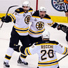 Boston Bruins center Patrice Bergeron , left, celebrates with teammates Brad Marchand and Mark Recchi after scoring against the Vancouver Canucks during the first period of Game 7 of the NHL hockey Stanley Cup Finals on Wednesday, June 15, 2011, in Vancouver, British Columbia. (AP Photo/The Canadian Press, Jonathan Hayward)