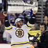 Nathan Horton lifts the Stanley Cup after the Boston Bruins beat the Vancouver Canucks 4-0 in Game 7 of the NHL hockey Stanley Cup Finals, Wednesday, June 15, 2011, in Vancouver, British Columbia. (AP Photo/Julie Jacobson)