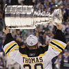 Bruins goalie Tim Thomas hoists the Stanley Cup after the Boston Bruins beat the Vancouver Canucks 4-0 during Game 7 of the NHL hockey Stanley Cup Finals, Wednesday, June 15, 2011, in Vancouver, British Columbia. (AP Photo/Julie Jacobson)