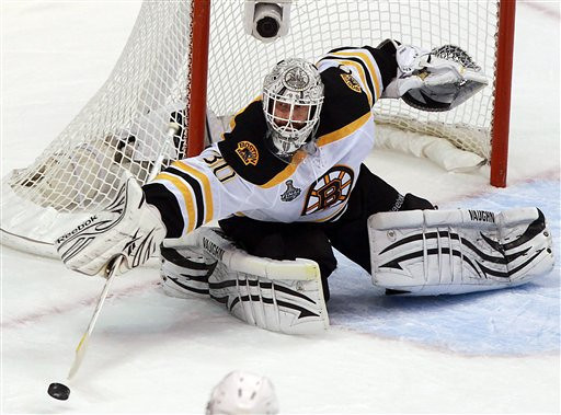 Boston Bruins goalie Tim Thomas turns the puck away against the Vancouver Canucks during the third period of Game 7 of the NHL hockey Stanley Cup Finals on Wednesday, June 15, 2011, in Vancouver, British Columbia. (AP Photo/The Canadian Press, Darryl Dyck)