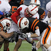 Beverly senior Luke McDonald hits Natick quarterback Troy Flutie hard to stop him short of a first down during the first quarter of play on Saturday evening. The Panthers defeated the Red Hawks 28-21 to capture their second Super Bowl title in three seasons. David Le/Staff Photo