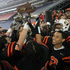 The Beverly High School football team holds the Eastern Mass D2A Super Bowl trophy high above their heads as they celebrate their 28-21 victory over Natick to capture their second Super Bowl in three years at Gillette Stadium in Foxborough on Saturday evening. David Le/Staff Photo