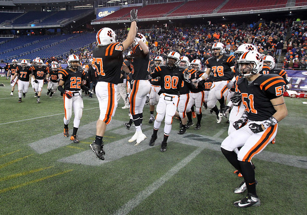 The Beverly High School football team gets fired up prior to the start of the Panthers D2A Super Bowl against Natick on Saturday evening at Gillette Stadium in Foxborough. David Le/Staff Photo