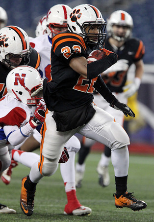 Beverly junior running back Isiah White breaks free from the Natick defense and rumbles for a big gain. White rushed for 87 yards on 11 carries and helped the Panthers to a 28-21 victory over the Red Hawks in the D2A Super Bowl at Gillette Stadium. David Le/Staff Photo