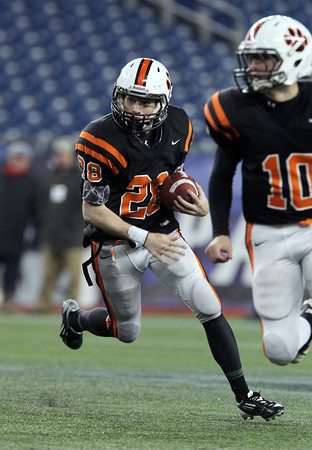 Beverly senior running back Kenny Pierce runs hard around the corner and into the open field against Natick on Saturday evening. Pierce rushed for 71 yards on 7 carries and added two touchdowns to help lead the Panthers to a 28-21 victory over Natick in the Eastern Mass D2A Super Bowl at Gillette Stadium. David Le/Staff Photo