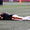 Beverly senior Ryan Shipp is overcome with emotion and lies face-down on the field at Gillette Stadium after the Panthers defeated Natick 28-21 to win their second Super Bowl title in three years. David Le/Staff Photo