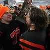 Beverly seniors Marc Babcock, right, and Mike Dooling, left, kiss the Super Bowl trophy following a 28-21 Panther victory over Natick on Saturday evening at Gillette Stadium in Foxborough. David Le/Staff Photo