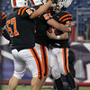 Beverly senior Marc Babcock, left, and junior Zach Duguid, center, congratulate senior running back Kenny Pierce on his second rushing touchdown of the night. The Panthers defeated the Red Hawks of Natick 28-21 to capture their second Super Bowl title in three years. David Le/Staff Photo