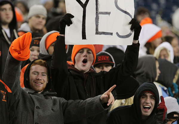 From left, Beverly High School seniors Conor Leahy, Jay Richardson, and Andrew Poveromo cheer on the Panthers as they took on Natick in the D2A Super Bowl on Saturday evening. Beverly defeated the Red Hawks 28-21 to capture their second Super Bowl title in three years at Gillette Stadium in Foxborough. David Le/Staff Photo