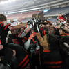The Beverly High School Panthers hoist the D2A Super Bowl trophy over their heads after defeating Natick 28-21 at Gillette Stadium on Saturday evening. David Le/Staff Photo