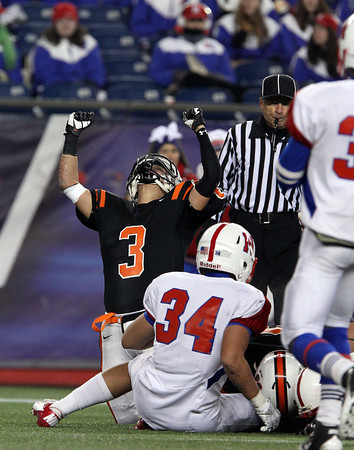 Beverly senior Ryan Shipp pumps his fists in the air after the Panthers recovered a Natick fumble in the second half of play on Saturday evening in the D2A Super Bowl at Gillette Stadium in Foxborough. David Le/Staff Photo