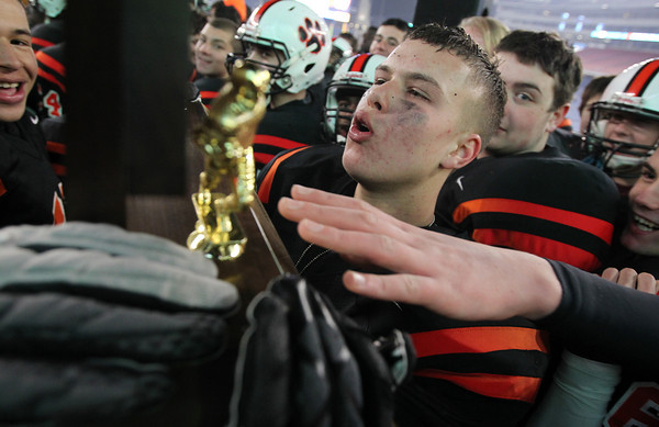 Beverly High School senior Ryan Shipp kisses the D2A Super Bowl trophy after the Panthers downed the Red Hawks of Natick 28-21 on Saturday evening at Gillette Stadium. David Le/Staff Photo