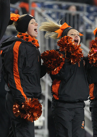 Beverly High School sophomore cheerleaders Kendel Davey, left, and Rachel Shipp, scream in excitement after the Panthers scored the first of their four touchdowns against Natick in the D2A Super Bowl on Satuday evening at Gillette Stadium in Foxborough. David Le/Staff Photo