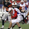Beverly junior Zach Duguid tackles Natick quarterback Troy Flutie for a loss of yards during the second half of the D2A Super Bowl at Gillette Stadium on Saturday evening. David Le/Staff Photo