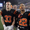 Beverly High School seniors Brendan Flaherty, and Brian Perry, left, and junior Isiah White, right, listen to the National Anthem play after their 28-21 victory over Natick in the D2A Super Bowl at Gillette Stadium on Saturday night. David Le/Staff Photo