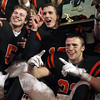 Beverly High School senior captains Dom Abate, Dave Rollins, and Brendan Flaherty pose with the Eastern Mass D2A Championship trophy after the Panthers defeated Natick 28-21 in the Super Bowl at Gillette Stadium. David Le/Staff Photo