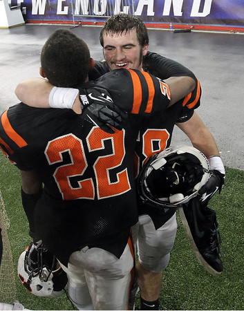 Beverly senior Brian Perry, right, hugs junior teammate Isiah White after the Panthers 28-21 victory over Natick to capture the Panthers second Super Bowl title in three years at Gillette Stadium on Saturday evening. David Le/Staff Photo