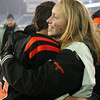 Beverly High School senior Katie Wheatley gives classmate Ryan Shipp a hug after Shipp and the Panthers defeated Natick 28-21 in the D2A Super Bowl to take home the program's second title in three years. David Le/Staff Photo