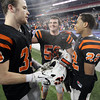 Beverly High School seniors Brendan Flaherty, and Brian Perry, left, celebrate the Panthers 28-21 victory over Natick in the D2A Super Bowl with junior Isiah White, right, on Saturday evening at Gillette Stadium. David Le/Staff Photo