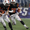 Beverly senior Brendan Flaherty turns the corner and breaks into the open in the first quarter of play against Natick on Saturday evening. Flaherty led the Panthers with 175 yards and 2 touchdowns and Beverly captured their second Super Bowl title in three years. David Le/Staff Photo