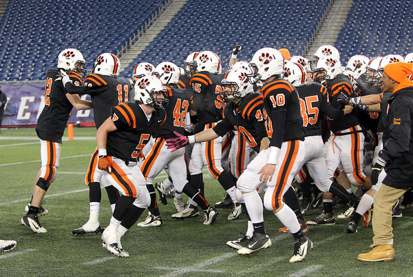 The Beverly High School Panthers flood the field at Gillette Stadium after they defeated Natick 28-21 to capture the team's second Super Bowl Title in three years. David Le/Staff Photo