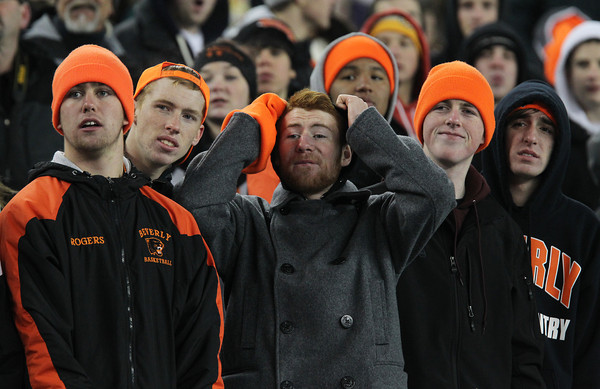 Beverly fans that filled the seats at Gillette Stadium to watch the Panthers take on the Red Hawks of Natick in the D2A Super Bowl react to a play during the third quarter of play on Saturday evening. David Le/Staff Photo