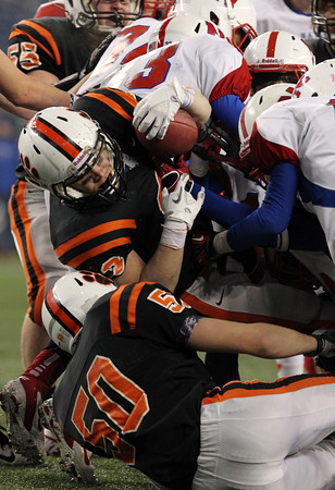 Beverly senior running back Brendan Flaherty powers his way through a pile of defenders to gain a few extra yards during the D2A Super Bowl at Gillette Stadium on Saturday evening. David Le/Staff Photo