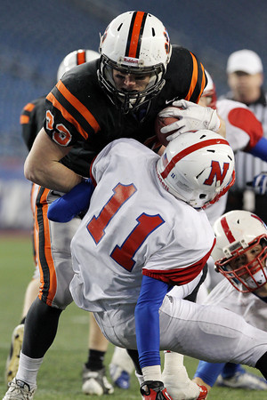 Beverly senior captain Brendan Flaherty runs over Natick defender Mike Abbruzzese and into the endzone to score his first touchdown of the night. Flaherty led the Panthers to a 28-21 victory over the Red Hawks behind 175 yards rushing and two scores. With the win, Beverly captures their second Super Bowl title in the past three years for Head Coach Dan Bauer. David Le/Staff Photo