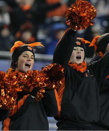 Beverly High School cheerleaders Katie Santo, left, and Taytum Geary, right, cheer on the Panthers after they scored their first touchdown of the night against Natick in the D2A Super Bowl on Saturday evening. David Le/Staff Photo