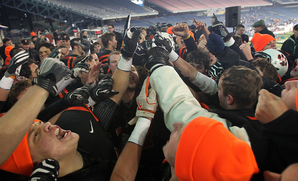 The Beverly High football team breaks down their huddle one last time for the 2012 season after defeating Natick 28-21 in the D2A Super Bowl and capturing their second Super Bowl title in three years. David Le/Staff Photo
