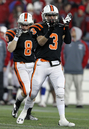 Beverly High School senior Ryan Shipp claps his hands after the Panthers came up with a key stop against Natick on Saturday evening in the D2A Super Bowl. David Le/Staff Photo