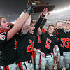 From left, Beverly High School senior captains Marc Babcock, Kenny Pierce, Dave Rollins, Dom Abate, and Brendan Flaherty hoist the D2A Super Bowl trophy high over their heads after defeating Natick 28-21 on Saturday evening. David Le/Staff Photo