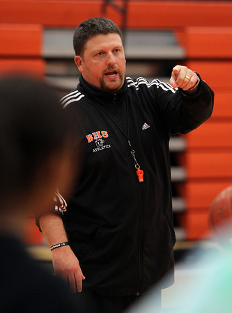 Beverly High School Head Coach Matt Smith gives directions to his team at practice on Friday afternoon. David Le/Staff Photo