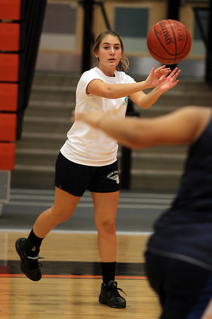 Senior captain Jill Stirrat passes the ball upcourt to a teammate at practice on Friday afternoon. David Le/Staff Photo