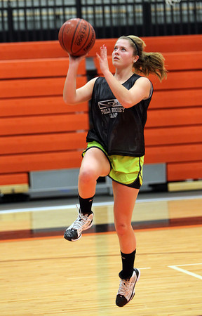 Beverly junior MaryCate Flaherty goes up for a layup at practice on Friday afternoon. David Le/Staff Photo