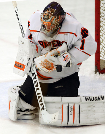 Beverly sophomore goalie Tim Birarelli makes a glove save against Saugus in the 1st period of play on Wednesday evening at the O'Keefe Center at Salem State University. David Le/Staff Photo