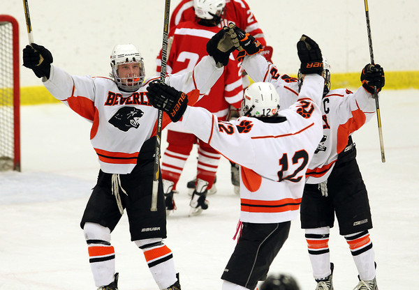 Beverly senior captain Andrew Irving, left, junior Jack Morency, center, and junior captain Connor Irving celebrate Morency's goal against Saugus in the 3rd period of play on Wednesday evening. David Le/Staff Photo