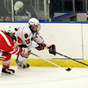 Beverly junior captain Connor Irving, right, controls the puck along the boards while being pursued by Saugus sophomore Nik Straticos, left, on Wednesday evening at the O'Keefe Center at Salem State. David Le/Staff Photo