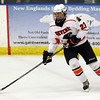 Beverly junior forward JJ Bachini stick handles with the puck in the offensive zone and looks to pass against Saugus during the 2nd period of play on Wednesday evening. David Le/Staff Photo