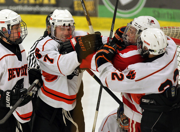 Beverly senior captain Andrew Irving, left, and Saugus Sophomore Chris Sanderson, center, exchange pleasantries in front of the Beverly net after a stoppage in play on Wednesday night. In a heated rematch of last season's first round D2 playoff game, the Panthers came out on top, beating the Sachems 7-0 at the O'Keefe Center at Salem State University. David Le/Staff Photo