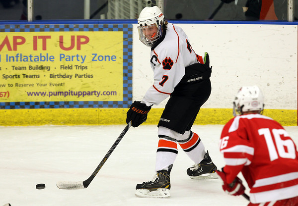 Beverly senior captain Andrew Irving flips the puck backhanded to a teammate in the 2nd period of play against Saugus on Wednesday evening. In a rematch of last years D2 state tournament first round game, the Panthers came out on top 7-0 to advance to 3-0 on the season. David Le/Staff Photo