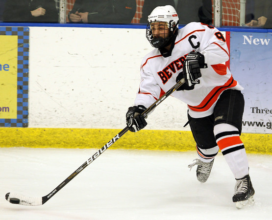Beverly junior captain and defenseman Matt Hamor saucers a pass across ice to a teammate during the 2nd period of play on Wednesday evening. David Le/Staff Photo