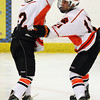 Beverly junior captain Connor Irving, left, congratulates junior teammate Ryan Santo on his 2nd period goal against Saugus on Wednesday evening. David Le/Staff Photo