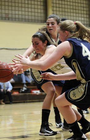 Bishop Fenwick senior Rose Fantozzi, center, battles for a loose ball in between two Arch Bishop Williams defenders on Tuesday evening. David Le/Staff Photo