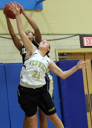 Bishop Fenwick senior captain Samantha Borelli, right, battles for a rebound with Williams sophomore Jaylen Wiliams on Tuesday evening. David Le/Staff Photo