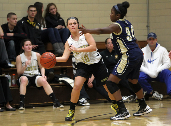 Bishop Fenwick sophomore Lexie Rose looks to pass around the outstretched arms of a Williams defender on Tuesday evening. David Le/Staff Photo