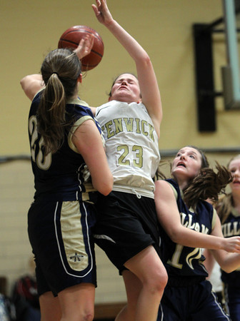 Bishop Fenwick junior Gianna Pizzano, center has her shot blocked by Arch Bishop Williams defender Olivia Conrad, left, as Kayla Free, right, looks on. David Le/Staff Photo